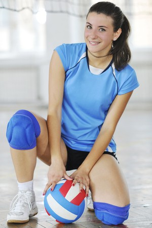 volleyball game sport with group of young beautiful girls\ indoor in sport arena