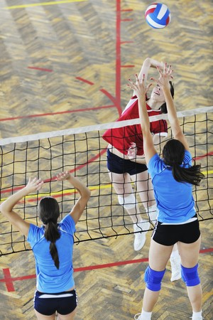 volleyball game sport with group of young beautiful  girls indoor in sport arena Stock Photo - 7829620