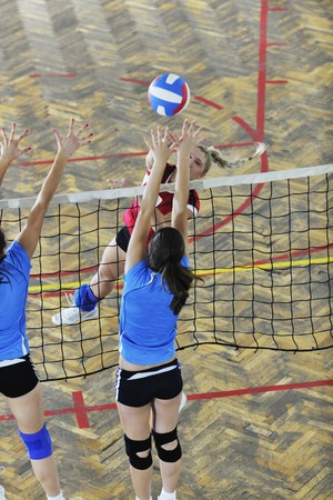 volleyball game sport with group of young beautiful  girls indoor in sport arena Stock Photo - 7682545