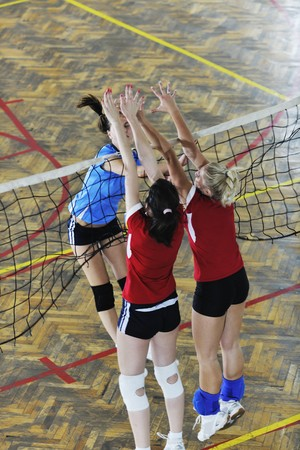 volleyball game sport with group of young beautiful  girls indoor in sport arena Stock Photo - 7682544