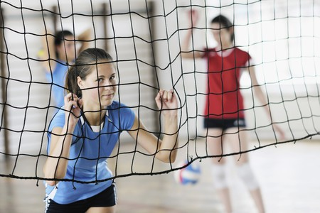 volleyball game sport with group of young beautiful  girls indoor in sport arena Stock Photo - 7829524