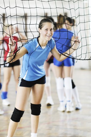 volleyball game sport with group of young beautiful  girls indoor in sport arena Stock Photo - 7829523