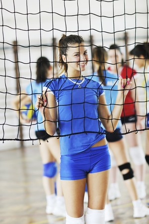 youngster  girl: volleyball game sport with group of young beautiful  girls indoor in sport arena Stock Photo