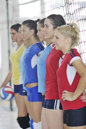 volleyball game sport with group of young beautiful  girls indoor in sport arena Stock Photo - 7821051