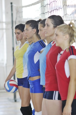 volleyball game sport with group of young beautiful  girls indoor in sport arena Stock Photo - 7821048