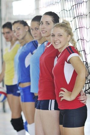volleyball game sport with group of young beautiful  girls indoor in sport arena Stock Photo - 7821054