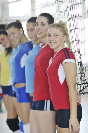 volleyball game sport with group of young beautiful  girls indoor in sport arena Stock Photo - 7821052