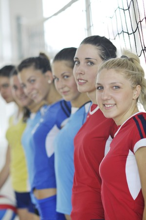 volleyball game sport with group of young beautiful  girls indoor in sport arena Stock Photo - 7821050