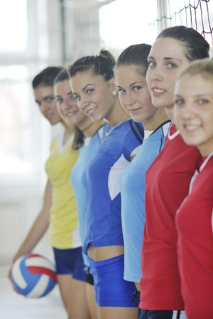 volleyball game sport with group of young beautiful  girls indoor in sport arena Stock Photo - 7821045