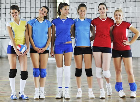 volleyball game sport with group of young beautiful  girls indoor in sport arena Stock Photo - 7829540