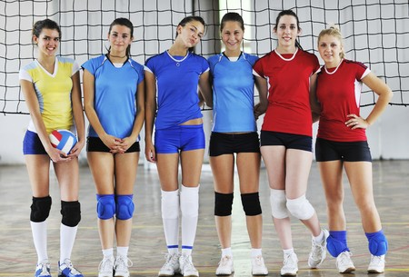 volleyball game sport with group of young beautiful  girls indoor in sport arena Stock Photo - 7829626