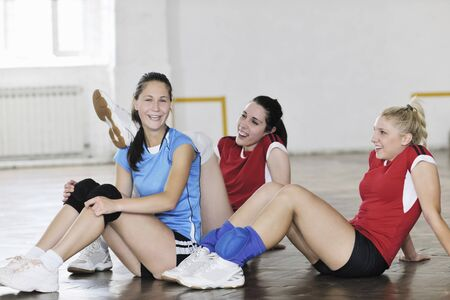 volleyball game sport with group of young beautiful  girls indoor in sport arena Stock Photo - 7956037