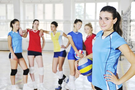 youth sports: volleyball game sport with group of young beautiful  girls indoor in sport arena Stock Photo