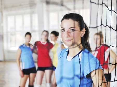 volleyball game sport with group of young beautiful  girls indoor in sport arena Stock Photo - 7821047