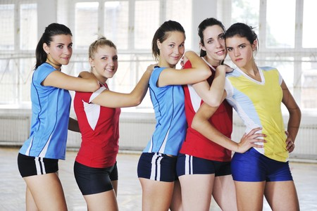 volleyball game sport with group of young beautiful  girls indoor in sport arena Stock Photo - 7821049