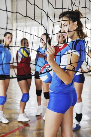 volleyball game sport with group of young beautiful  girls indoor in sport arena Stock Photo - 7821053