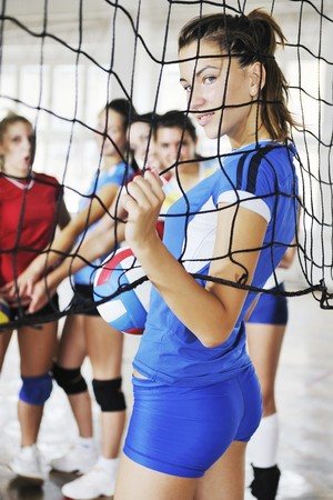 indoor sport: volleyball game sport with group of young beautiful  girls indoor in sport arena Stock Photo