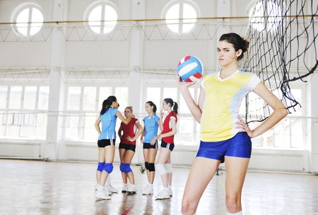 volleyball game sport with group of young beautiful  girls indoor in sport arena Stock Photo - 7829527