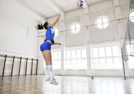 volleyball game sport with group of young beautiful  girls indoor in sport arena Stock Photo - 7829616