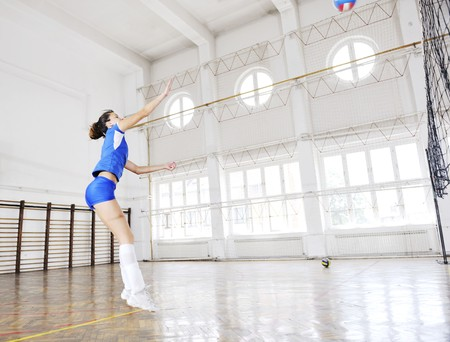volleyball game sport with group of young beautiful  girls indoor in sport arena Stock Photo - 7829526