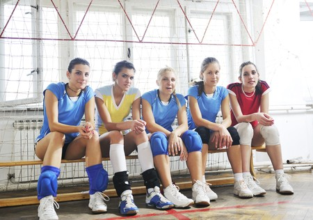 volleyball game sport with group of young beautiful  girls indoor in sport arena Stock Photo - 7829622