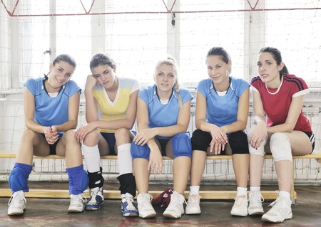 volleyball game sport with group of young beautiful  girls indoor in sport arena Stock Photo - 7829590