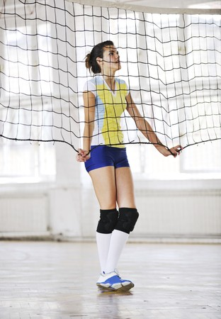 volleyball game sport with group of young beautiful  girls indoor in sport arena Stock Photo - 7622642