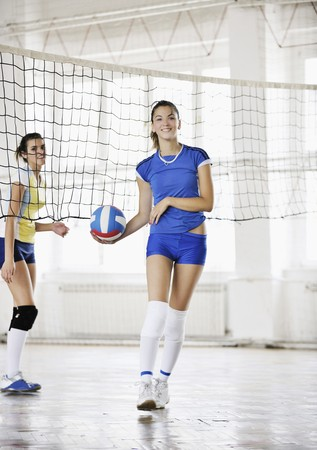 volleyball game sport with group of young beautiful  girls indoor in sport arena Stock Photo - 7622641