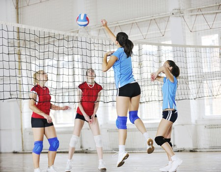 volleyball game sport with group of young beautiful  girls indoor in sport arena Stock Photo - 7814901