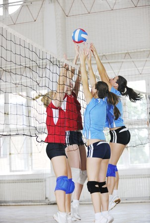 volley ball: volleyball game sport with group of young beautiful  girls indoor in sport arena Stock Photo