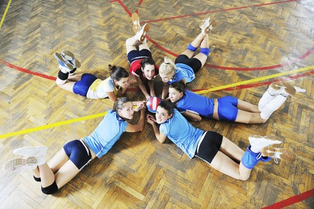 volleyball game sport with group of young beautiful  girls indoor in sport arena Stock Photo - 7814904