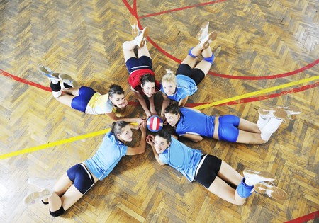 volleyball game sport with group of young beautiful  girls indoor in sport arena Stock Photo - 7814910