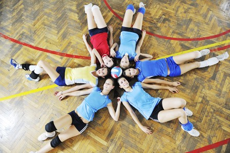 volleyball game sport with group of young beautiful  girls indoor in sport arena Stock Photo - 7814902