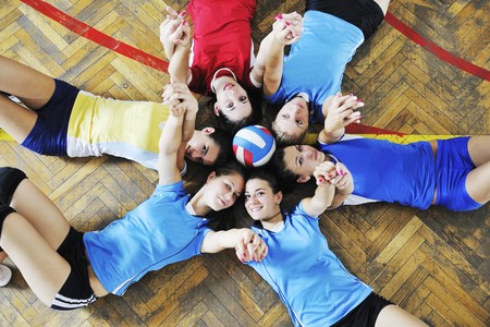 volleyball game sport with group of young beautiful  girls indoor in sport arena Stock Photo - 7814909