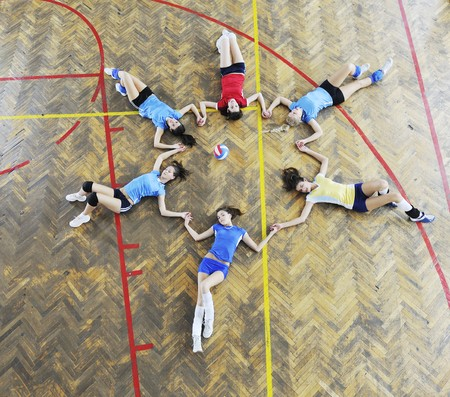 volleyball game sport with group of young beautiful  girls indoor in sport arena Stock Photo - 7814903