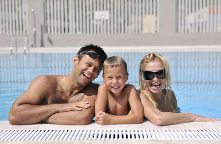 happy young family have fun on swimming pool  at summer vacation Stock Photo - 7616975