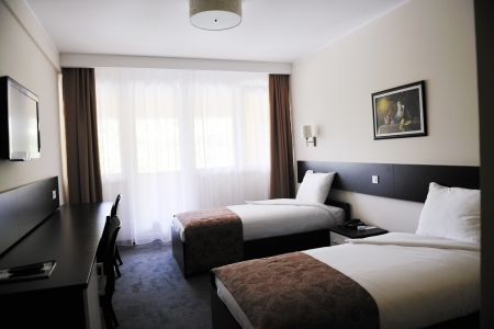 luxury hotel room: bright and clean hotel room interior with modern furniture