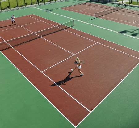 tennis racquet: happy young couple play tennis game outdoor man and woman