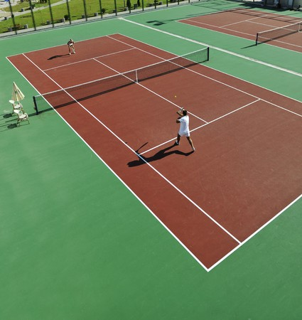 7776689: happy young couple play tennis game outdoor man and woman