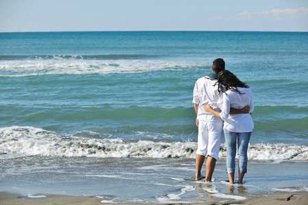 happy young couple in white clothing  have romantic recreation and   fun at beautiful beach on  vacations Stock Photo - 8237374