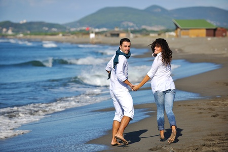 happy young couple in white clothing  have romantic recreation and   fun at beautiful beach on  vacations Stock Photo - 8236918