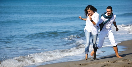 happy young couple in white clothing  have romantic recreation and   fun at beautiful beach on  vacations Stock Photo - 8234958