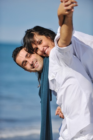 happy young couple in white clothing  have romantic recreation and   fun at beautiful beach on  vacations Stock Photo - 8237107