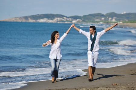 happy young couple in white clothing  have romantic recreation and   fun at beautiful beach on  vacations Stock Photo - 8237109