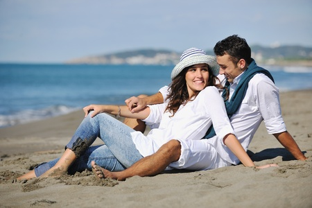 happy young couple in white clothing  have romantic recreation and   fun at beautiful beach on  vacations Stock Photo - 8237373