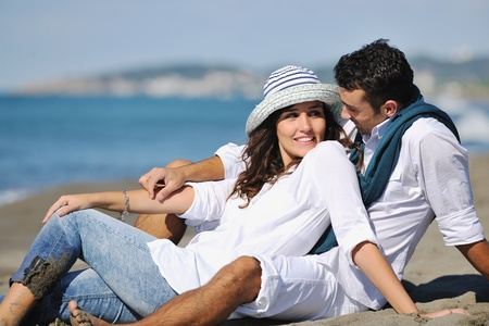 happy young couple in white clothing  have romantic recreation and   fun at beautiful beach on  vacations Stock Photo - 8237486