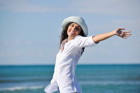 happy young woman relax onbeautiful  beach at morning Stock Photo - 8236125