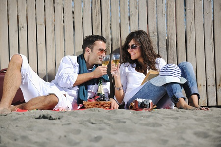 happy young couple enjoying  picnic on the beach and have good time on summer vacations Stock Photo - 8239034