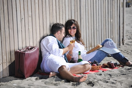 happy young couple enjoying  picnic on the beach and have good time on summer vacations Stock Photo - 8238915