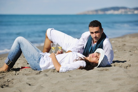 happy young couple in white clothing  have romantic recreation and   fun at beautiful beach on  vacations Stock Photo - 8237515